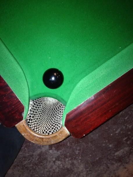cheshire B&W cushions ball in pocket