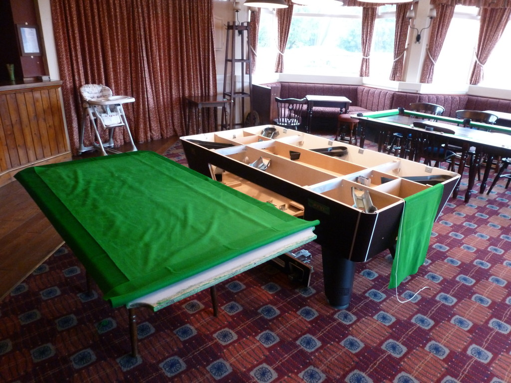 Pool table hire for nottingham derby area we supply the best the slate out of the table with new cloth laid out and old cloth on top to protect from glue contamination when we spread glue to side of slate watchthetrailerfo