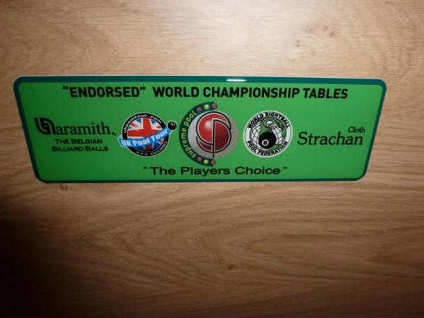 winner-badge world championship table green