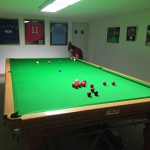 steve-butler-playing-on-table-sports-shirts-on-wall